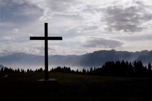 Cross in front of mountains
